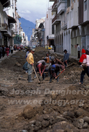 Tough manual process to repair the aging sewer system beneath the cobbled streets of Cuenca (Ecuador).