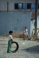 Child playing with old tire in Tena (Amazonas, Ecuador)