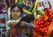 Kuna Indian girl with Chestnut-mandibled Toucan