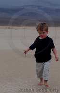 Child walking on floor of Panamint Valley, Death Valley National Park.