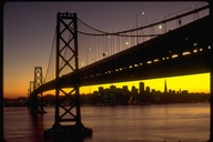 View of the Bay Bridge and the San Francisco skyline at sunset