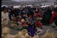 Basket vendors in a market, Saquisili, Ecuador, 1970