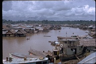 Floating houses and boats in and along river in Belen, Peru, 1972