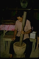 Philippine man grinding seeds with a mortar and pestle, Republic of the Philippines, 1973