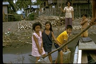 Philippine children carrying water