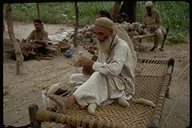 Man spinning wool