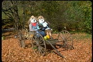 Two Scarecrows taking a ride during Autumn in Vermont
