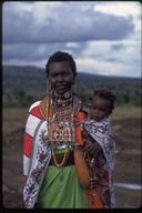 Masai native woman in costume with child in Kenya