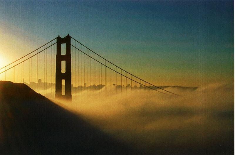 golden gate bridge fog. Golden Gate Bridge in sunrise